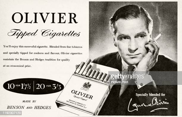 English actor Laurence Olivier is shown smoking a cigarette in an advertisement for Benson Hedges' Olivier cigarettes Original Publication Picture...