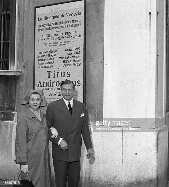 English actor Laurence Olivier with his wife Vivien Leigh portrayed before a poster of the 'Titus Andronicus' play Venice 1957