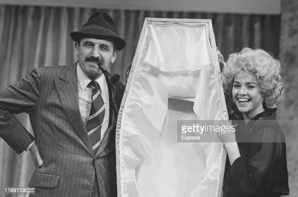 English actor Leonard Rossiter as 'Inspector Truscott' and Irish actress Gemma Craven as 'Nurse Fay' in play 'Loot' at the Ambassador's Theatre...
