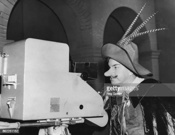 English actor Leslie Banks as Cyrano de Bergerac during dress rehearsals for a live television broadcast of Rostand's play at the Alexandra Palace...