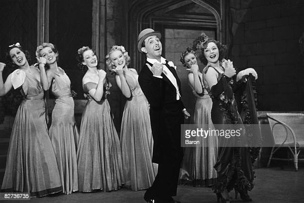 English actor Lupino Lane Teddie St Denis and other cast members doing the Lambeth Walk in a scene from the musical comedy 'Me And My Girl' at the...