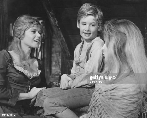 English actor Mark Lester with costars Shani Wallis and Sheila White on the set of the musical film version of 'Oliver' 1967 From left to right they...