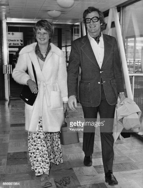 English actor Michael Caine arrives at Heathrow Airport with his daughter Dominique en route to attend the Oscars in Hollywood 21st March 1973