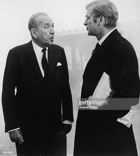 English actor Michael Caine as Charlie Croker and Noel Coward as Mr Bridger in Paramount Pictures' 'The Italian Job' 1969 This funeral scene was shot...
