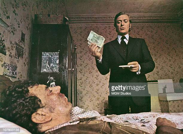 English actor Michael Caine as Jack Carter and Alun Armstrong as Keith in Mike Hodges' thriller 'Get Carter' 1970