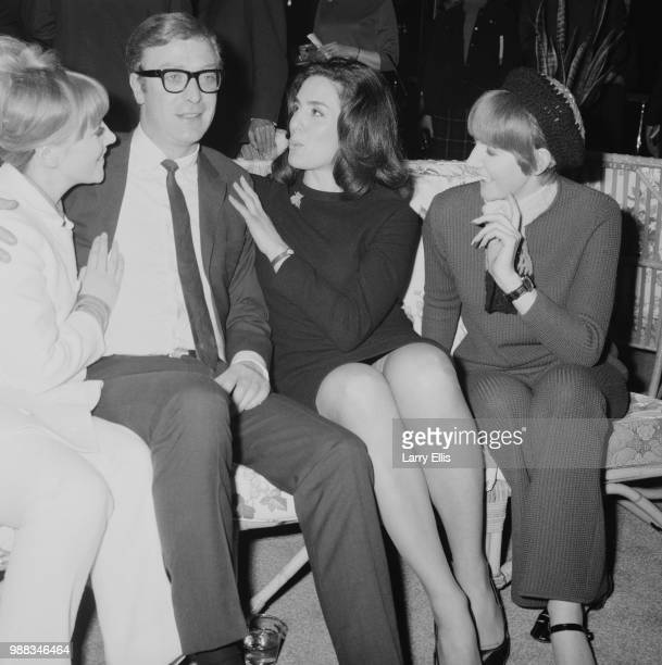 English actor Michael Caine pictured with from left Julia Foster Eleanor Bron and Cilla Black at a function in London on 18th March 1966 Michael...