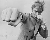 English actor michael caine throwing a punch august 1965 picture id2662385?s=170x170