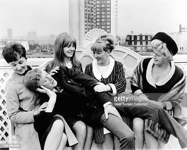 English actor Michael Caine with his costars in 'Alfie' directed by Lewis Gilbert London 1966 Left to right Vivien Merchant Jane Asher Julia Foster...