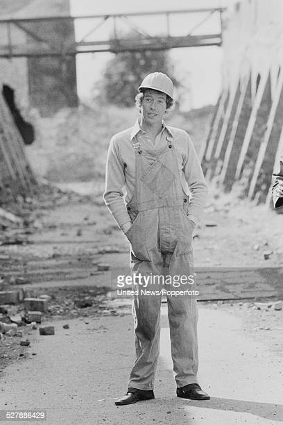 English actor Michael Crawford, dressed in dungarees and a hard hat, in character as Frank Spencer during filming of the television comedy series...