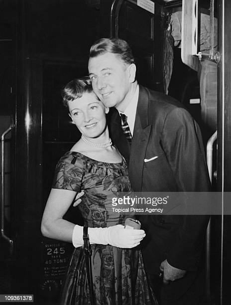 English actor Michael Redgrave bids goodbye to his wife actress Rachel Kempson at Waterloo Station in London before leaving for America on the 'Queen...