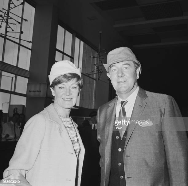 English actor Michael Redgrave with his wife English actress Rachel Kempson at Heathrow Airport before leaving for Venice London UK 12th June 1967