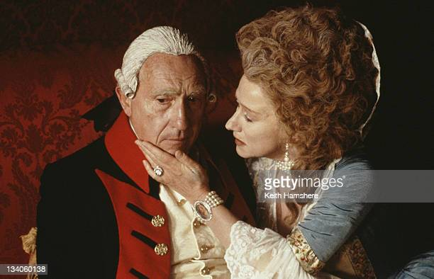 English actor Nigel Hawthorne as King George III and actress Helen Mirren as Queen Charlotte in the film 'The Madness of King George' 1994