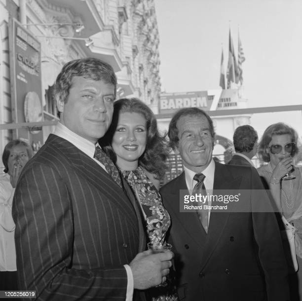 English actor Oliver Reed an unidentified woman and American businessman George Barrie of Brut Productions attend the 31st Cannes Film Festival...