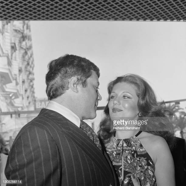 English actor Oliver Reed and an unidentified woman attend the 31st Cannes Film Festival, Cannes, France, May 1978.