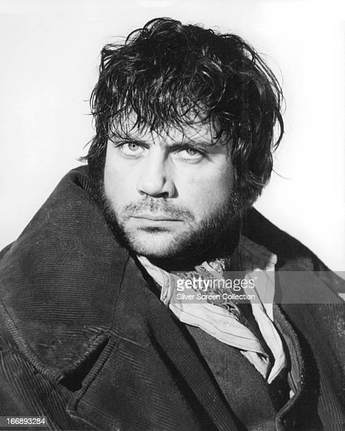 English actor Oliver Reed as Bill Sikes in a promotional portrait for 'Oliver' directed by Carol Reed 1968