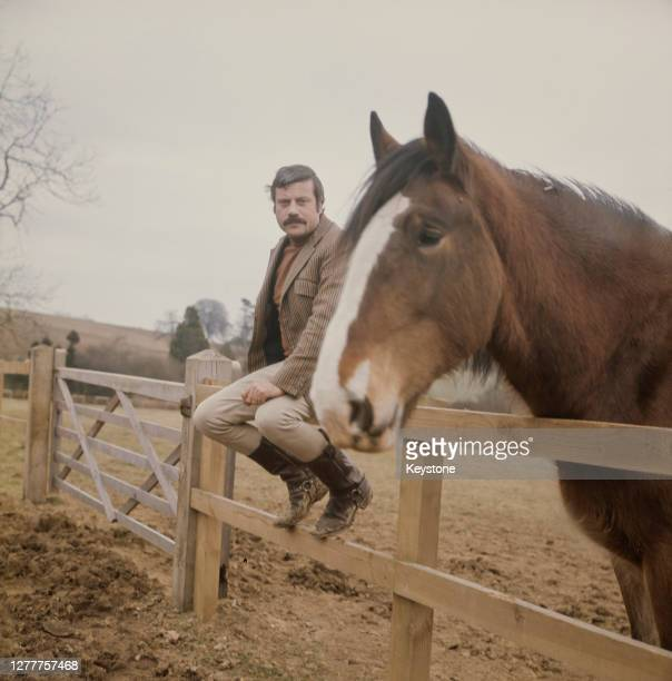 English actor Oliver Reed in the countryside near his home, UK, circa 1973.