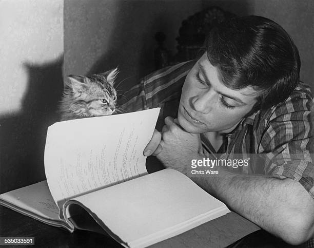 English actor Oliver Reed reading through his script in preparation for his forthcoming role in the Hammer horror film 'The Curse Of The Werewolf'...
