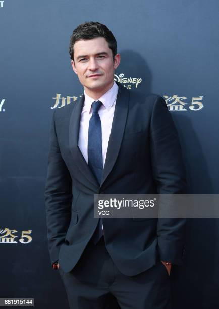 English actor Orlando Bloom attends the premiere of film 'Pirates of the Caribbean Dead Men Tell No Tales' at Shanghai Disneyland Park on May 11 2017...