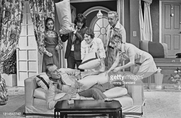 English actor Patrick Cargill being attacked with pillows by actors Barbara Flynn, Richard Beckinsale , Diana King , Terence Alexander and Jane Downs...