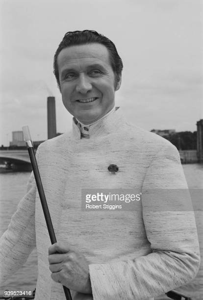 English actor Patrick Macnee , dressed as a lion tamer, London, UK, 15th July 1968.
