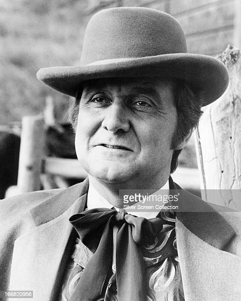 English actor Patrick Macnee in a western outfit, circa 1975.