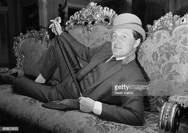 English actor Patrick Macnee reclines on a sofa, 20th May 1965.