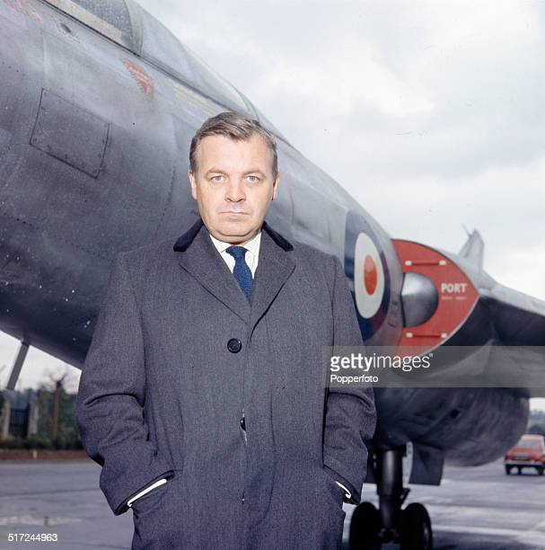 English actor Patrick Wymark in front of the Scott-Furlong Predator VTOL aircraft from the television series 'The Plane Makers' in 1964.