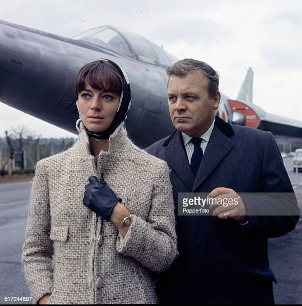 English actor Patrick Wymark posed with actress Wendy Gifford in front of the Scott-Furlong Predator VTOL aircraft from the television series 'The...
