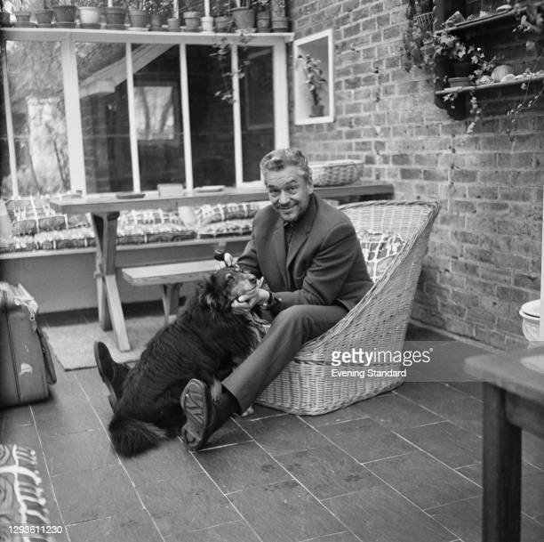 English actor Paul Scofield with his dog, UK, 11th April 1967.