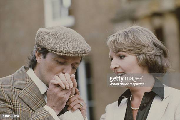 English actor Peter Bowles kisses the hand of actress Penelope Keith in character as Richard DeVere and Audrey fforbesHamilton from the television...
