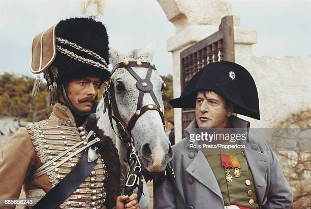 English actor Peter McEnery and American actor Eli Wallach dressed in character as Colonel Gerard and Napoleon Bonaparte respectively, pictured...