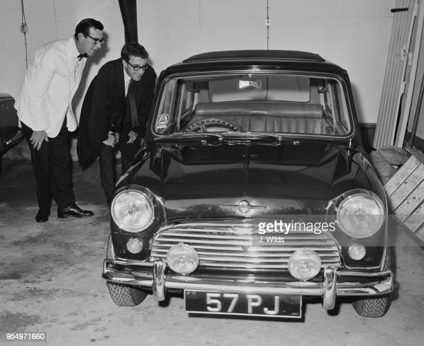 English actor Peter Sellers admires his Mini Cooper upon his return to his home in Surrey UK 8th June 1964 The car was modified while he was away in...
