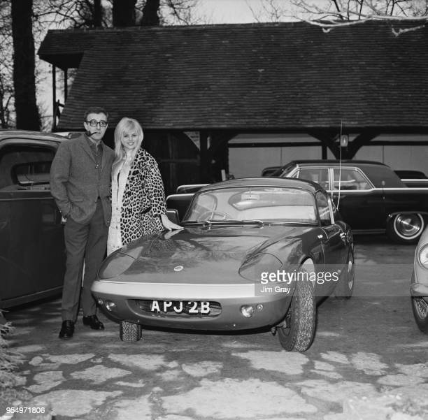English actor Peter Sellers presents a Lotus Elan to his fiancée actress Britt Ekland 12th February 1964