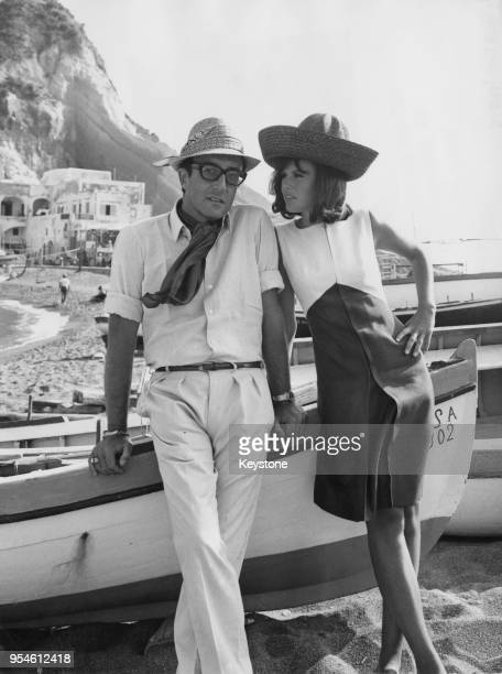 English actor Peter Sellers with his wife actress Britt Ekland in the village of SantAngelo Ischia Italy during the filming of 'Caccia alla Volpe'...