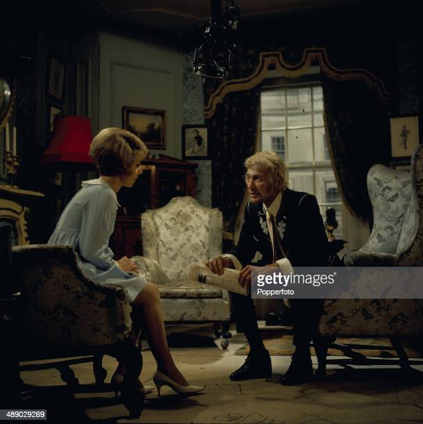 English actor Peter Wyngarde pictured with actress June Barry in a scene from the television drama 'Love Story It's a Long Way to Translyvania' in...