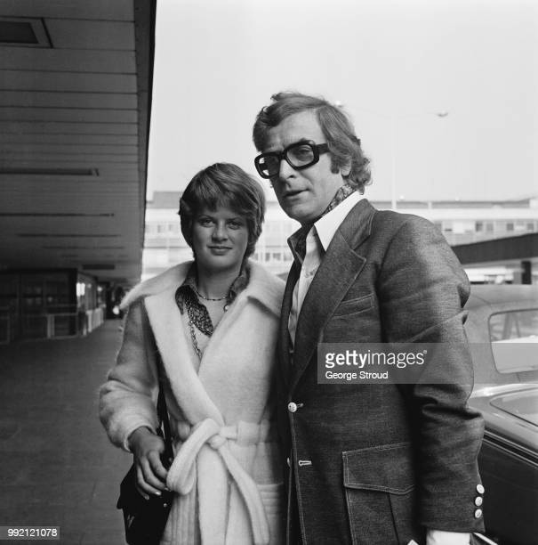 English actor producer and author Michael Caine with his daughter Dominique at Heathrow Airport London UK 21st March 1973