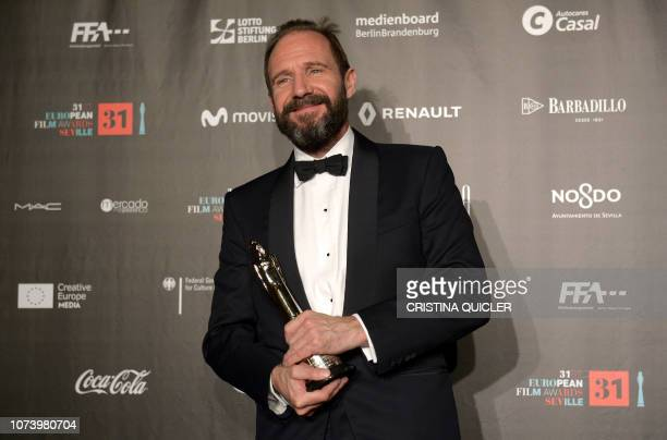 English actor Ralph Fiennes poses with his European Achievement in World Cinema award during the 2018 European Film Awards ceremony at the Maestranza...