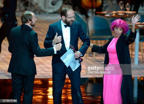 English actor Ralph Fiennes receives the European Achievement in World Cinema award from Spanish actress Victoria Abril during the 2018 European Film...