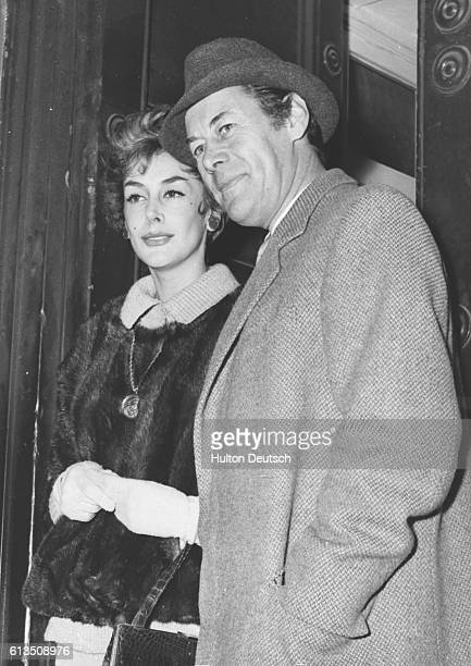 English actor Rex Harrison greets fans with his third wife actress Kay Kendall at Drury Lane London 1958