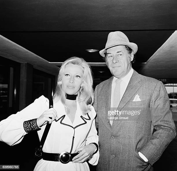 English actor Rex Harrison leaving London Airport with Welsh socialite Elizabeth ReesWilliams for a holiday in Portofino 17th May 1971 ReesWilliams...