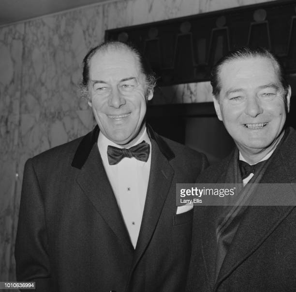 English actor Rex Harrison pictured on left with playwright Terence Rattigan at the premiere of the film 'The Yellow Rolls-Royce' in London on 31st...