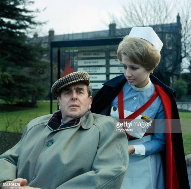 English actor Robert Morley pictured with actress Anne Lloyd in a scene from the television drama series 'Emergency Ward 10' in 1966