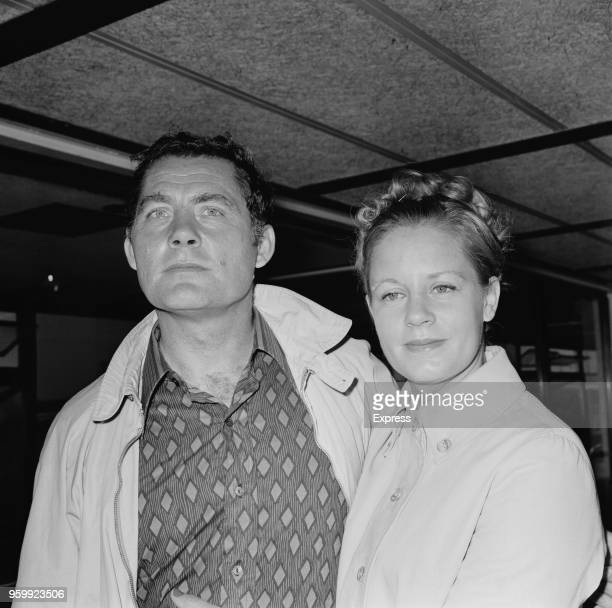 English actor Robert Shaw pictured with his wife Scottish actress Mary Ure at Heathrow airport in London as they arrive to catch a flight to Madrid...