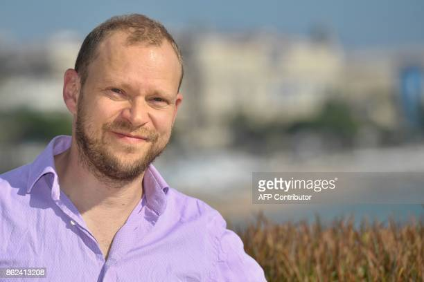 English actor Robert Webb poses during the MIPCOM trade show in Cannes southern France on October 17 2017 / AFP PHOTO / YANN COATSALIOU