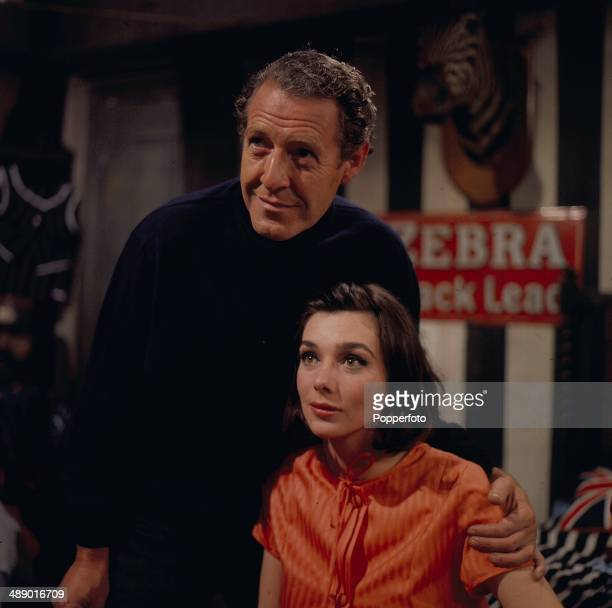 1966 English actor Robin Bailey pictured with actress Jacqueline Pearce in a scene from the television drama series 'Public Eye' in 1966