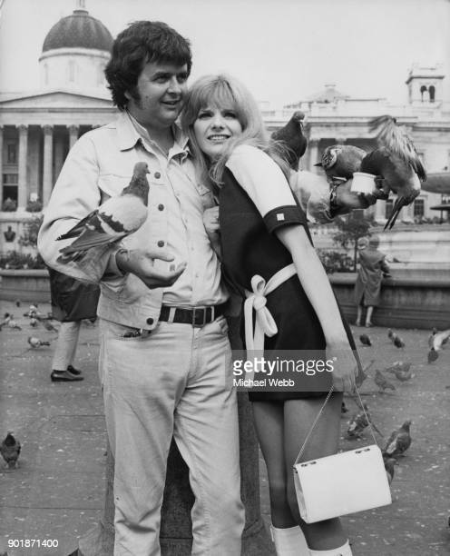 English actor Rodney Bewes poses with actress Sheila White amongst the pigeons in Trafalgar Square London 11th September 1969 They are both about to...