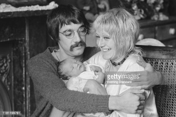 English actor Roger LloydPack and his wife Sheila Ball hold their newborn daughter Emily LloydPack in London in October 1970