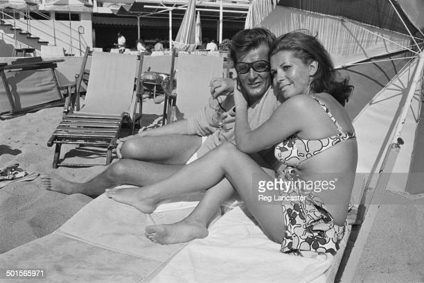 English actor Roger Moore and his wife Italian actress Luisa Mattioli on their honeymoon in Cannes France17th April 1969