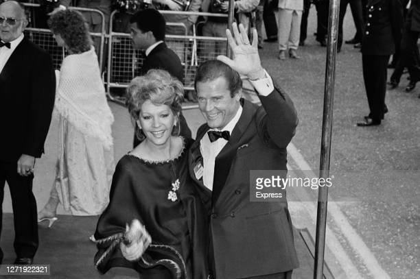 English actor Roger Moore and his wife Luisa Mattioli at the premiere of the James Bond film 'A View to a Kill', London, UK, 12th June 1985. Moore...