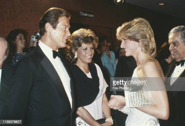English actor Roger Moore and his wife Luisa meet Diana Princess of Wales at the premiere of the James Bond film 'Octopussy' at the Odeon Leicester...